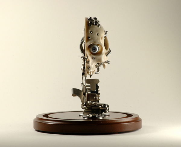 MINIATURE ROBOTIC CYBORG SKULL TITLED CHRONOS 1 BY ARTIST CHRISTOPHER CONTE