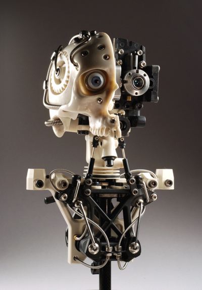 MINIATURE ROBOTIC CYBORG SKULL TITLED CYNTHETIC HALF BY ARTIST CHRISTOPHER CONTE